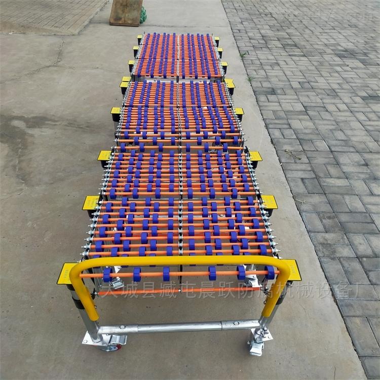 可伸缩 无动力卸货碳钢轮输送卸货神器